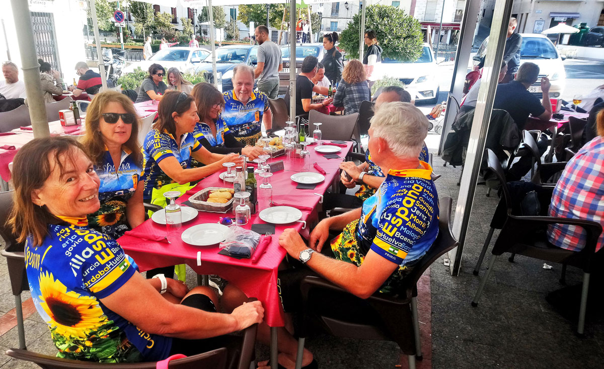 Cyclists having Paella in Spain